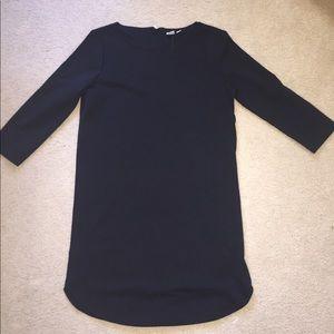 Black, form fitting business dress
